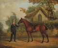 A gentleman holding a saddled bay hunter on a track, by a cottage - English School