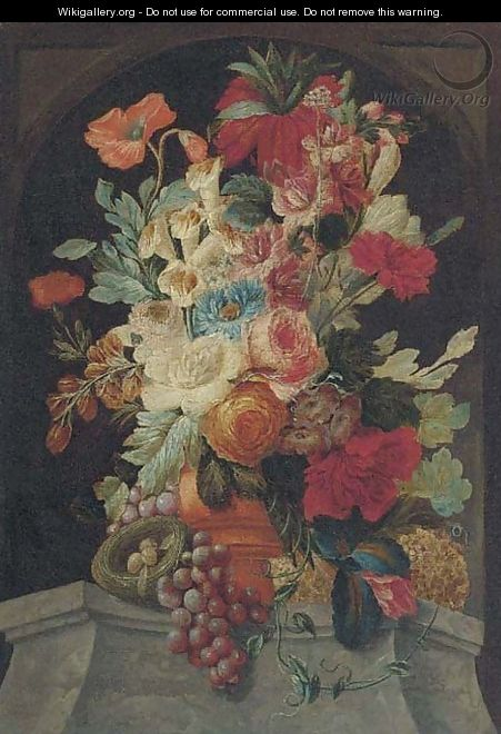 Mixed flowers in an urn on a ledge with grapes and a bird