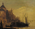 A town by a river with sailing vessels moored at a quay, at dusk - (after) Jacob Adriaensz. Bellevois