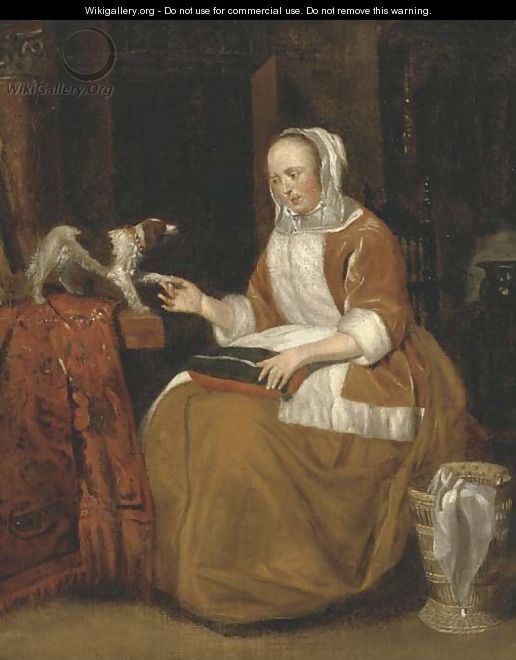 A lady seated in an interior, with a dog on a partly draped table - (after) Gerard Ter Borch