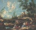 A landscape with anglers by a river, a town beyond - (after) Francesco Guardi