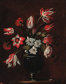 Carnations, tulips and other flowers in a glass vase on a ledge - (after) Bartolome Perez