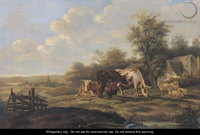 Milking cows in a landscape, with a town beyond - Dutch School