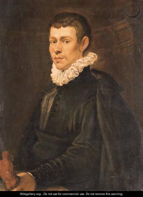 Portrait of a young sculptor, half-length, in a dark coat and jacket, holding a figurine - Domenico Tintoretto (Robusti)