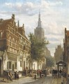 A sunny view of the Nieuwstraat in the Dutch town of Hasselt, with the St. Stephanus church beyond - Cornelis Springer