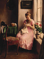 A girl in a pink dress sewing by the window - Emil Pap