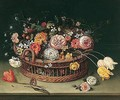 Still life of roses, tulips, bluebells and carnations in a wicker basket with a butterfly - (after) Jan The Elder Brueghel