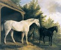 Two Hunters By A Stable With A Landscape Beyond - Richard Barrett Davis