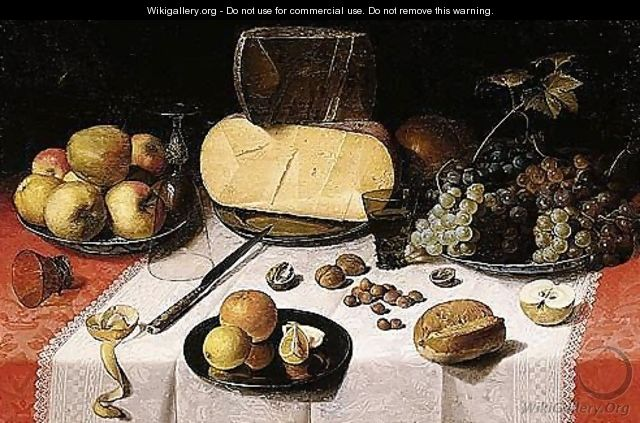 An Uitgestald Still Life Of Pears, Apples And Grapes On Blue-and-white Porcelain Bowls, Glass Roemers, A Knife, An Overturned Wine-glass, Apple-peel, An Orange And Lemons On A Pewter Plate, Walnuts And Hazelnuts, A Bread-roll, A Sliced Apple - Floris Claesz Van Dijck