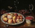 A Still Life Of Apples, Peaches And Pears In A Wan-li Porcelain Dish, Red Grapes In A Wan-li Porcelain Bowl, Plums And Raspberries On Pewter Plates, Figs In A Bowl, Facon-de-venise Wine-glasses, Together With A Butterfly, All Resting On A Wooden Table-top - Osias, the Elder Beert