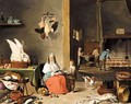 A Kitchen Interior With A Woman Peeling Fruit And Figures Cooking Over A Fire Beyond - (after) David The Younger Teniers