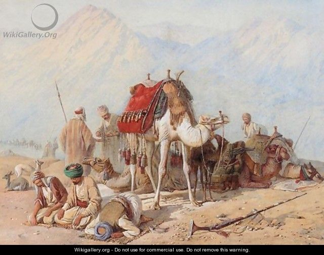 Arabs Praying In The Desert With A Caravan Of Camels Beyond - Joseph-Austin Benwell
