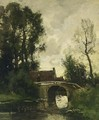 A Figure Crossing A Bridge In A Wooded Landscape - Theophile Emile Achille De Bock