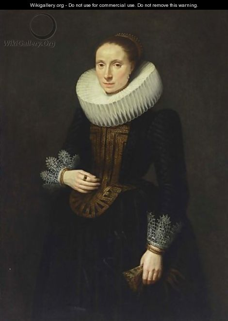 A Portrait Of A Lady, Standing Three-Quarter Length, Wearing A Black Dress With White Lace Cuffs And Collar And An Embroidered Bodice, Holding Gloves In Her Left Hand - (after) Cornelis De Vos