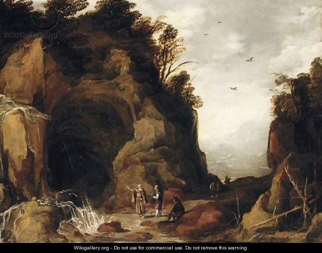 A Mountainous Landscape With Travellers And A Hermit Outside A Cave With A Waterfall - (after) Joos De Momper