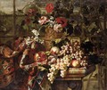 Still Life Of Various Flowers In A Bronze Urn, Together With Pomegranates, Grapes, Pears And Plums On A Marble Table Draped With A Carpet - Jean Baptiste Belin de Fontenay