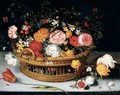 A Basket Of Tulips, Carnations, Roses And Other Flowers Resting On A Stone Ledge - (after) Jan The Elder Brueghel