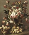 A Still Life Of Tulips, Roses, Carnations And Other Flowers In A Glass Vase Together With Fruit - Italian School