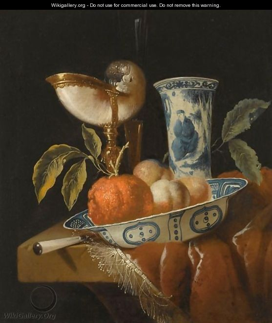 A Still Life With An Orange And Peaches In A Porcelain Wan-Li Bowl, A Nautilus Cup, A Chinese Porcelain Vase - Juriaan Van Streek