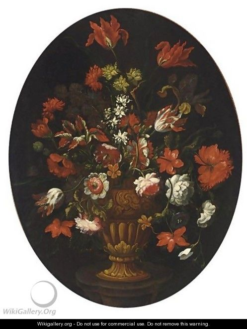 A Still Life With Tulips, Carnations, Roses And Other Flowers In A Vase On A Stone Table - North-Italian School