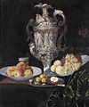 Still Life With An Elaborately Sculpted Urn And Blue And White Porcelain Bowls With Fruit - Georg Hinz