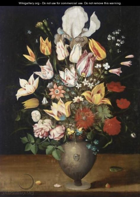 A Still Life With Parrot Tulips, Roses, Irises, And Various Other Flowers In A Vase On A Table Ledge - Antwerp School
