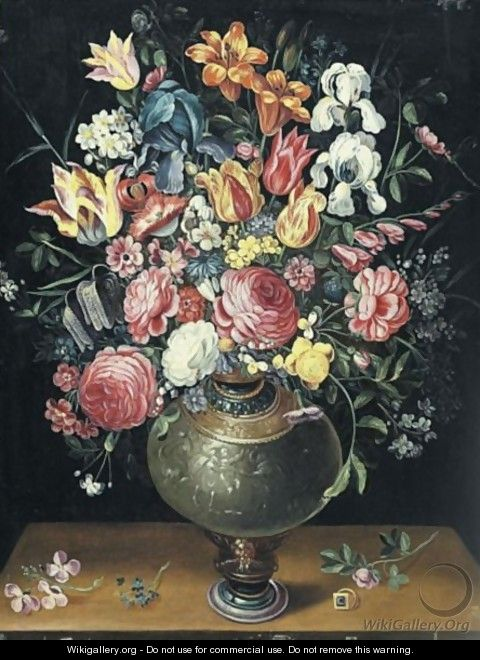 Still Life Of Roses, Tulips, Irises, Lilies And Other Summer Flowers In A Parcel Gilt Vase Beside A Ring Upon A Table - (after) Frans II Francken