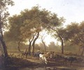 Two peasants with a herd of cattle on a wooded path leading to a lake - Jan Both