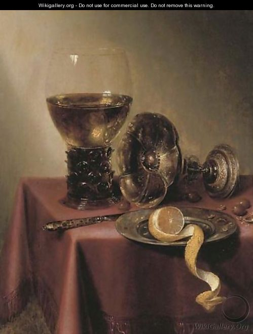 An upturned silver tazza, hazelnuts, a peeled lemon on a pewter platter, a knife and a roemer, on a draped table - Maerten Boelema De Stomme