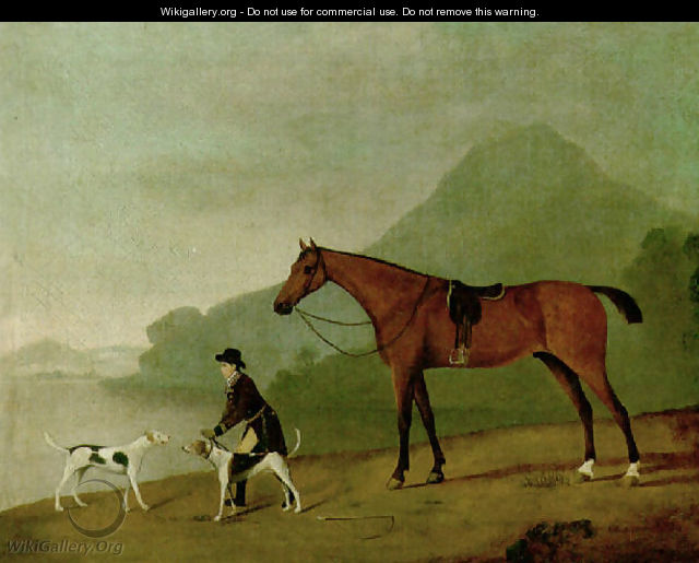 A saddled bay hunter with a groom and hounds, in a landscape - John Best