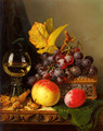A Still Life of Black Grapes, a Peach, a Plum, Hazelnuts, a Metal Casket and a Wine Glass on a Carved Wooden Ledge - Edward Ladell