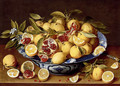 A Still Life Of A Wanli Kraak Porcelain Bowl Of Citrus Fruit And Pomegranates On A Wooden Table - Gerrit Van Honthorst